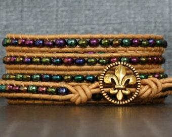 mardi gras jewelry - metallic jewel tone seed beads and pale gold leather wrap bracelet - fleur de lis button - NOLA