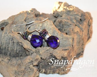Deep blue faceted glass briolettes wrapped with sterling silver and iris accent beads with sterling ear hooks
