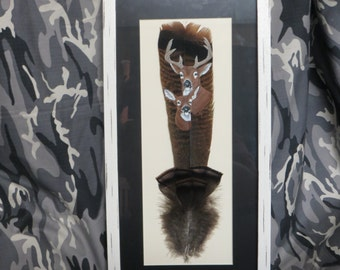 Beautiful buck and doe hand painted on an eastern wild turkey tail feather.