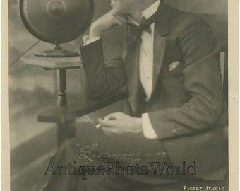 Ventriloquist C Johnston smoking by radio antique photo