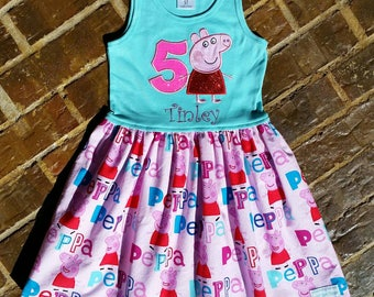Girl's appliquéd Peppa Pig dress with embroidered name and birthday number