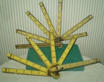 "2 vintage folding rulers- 72"" rulers- one Stanley brick mason ruler, one"