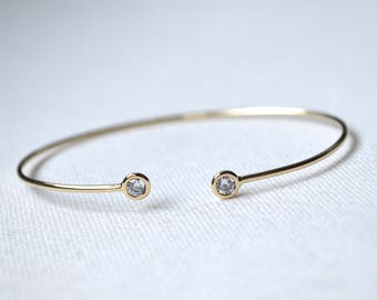 Open gold bracelet