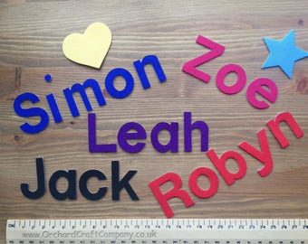 A set of 7 Fabric Iron On Letters/Numbers 4cm , Plain Colours, Upper and Lowercase. (No Sew)