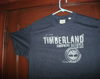 brand new Timberland t-shirt Designed To Last color is navy blue size large