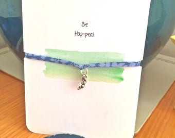 Liberty of London fabric bracelet with three peas in a pod charm