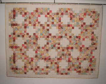 Romantic quilt in pastel shades