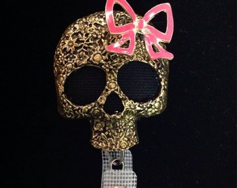 Cute skull with bow retractable badge reel