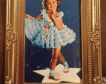 Shirley Temple colour print in a gold frame 6x4""