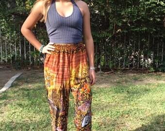 Baggy pants, cotton pants, small African animals, orange, black