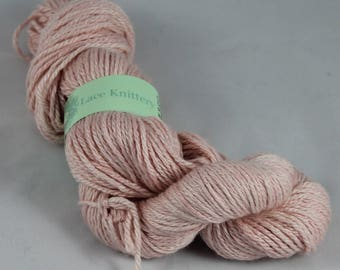 Hand painted hand dyed aran weight yarn in merino and silk in soft shell pink colours