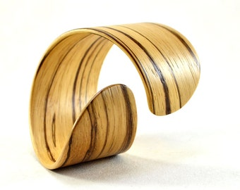 "Wooden Bracelet. ""Simple twist. Rounded"" Natural veneer. Zebrawood"