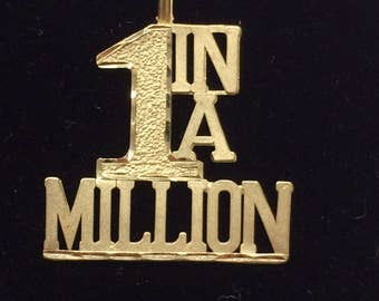 """VINTAGE 1980's 14K Yellow Gold """"1 In A Million"""" CHARM"""