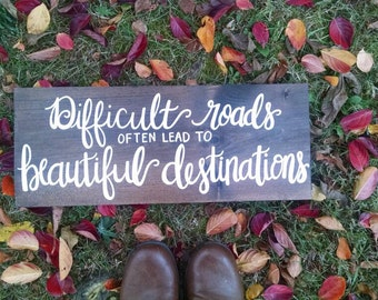 Difficult Roads Often Lead to Beautiful Destinations hand-painted wooden sign
