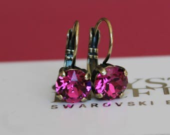 Antique Brass Plated Leverback Earrings made with Fuchsia Swarovski Crystal Elements. Earrings by Lady C