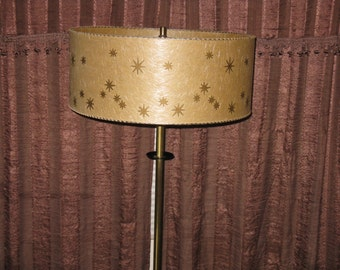 Mid Century Modern black and brass floor lamp original fiberglass shade stars