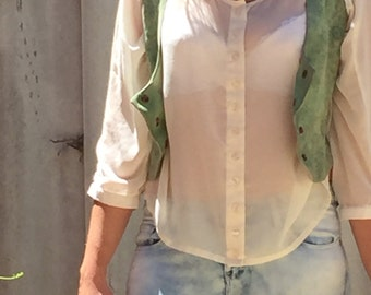 Green 1970s leather style vest