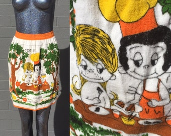 Vintage Love Is by Kim Casali terrycloth apron orange trim Love is Cooking together LA Times comic