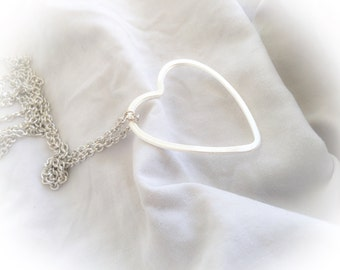 Long brass necklace with heart pendant silver
