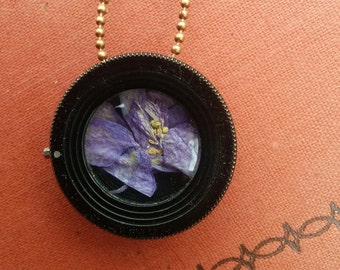 Antique camera lens necklace with pressed flower