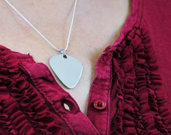 Guitar Plectrum necklace for music lovers, rock chick, guitar plectrum, necklace with silver plated chain.