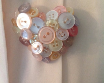 Unique, vintage Button pin.....heart shaped......beautiful pastel colored buttons.....quilted backing