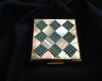 Elgin American mother of pearl and rhinestone compact in new conndition.