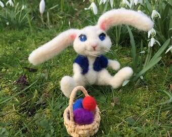 needle felted easter bunny rabbit with little basket of felt eggs