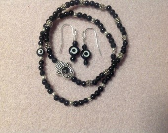 Black Evil Eye stretch bracelet and earring set
