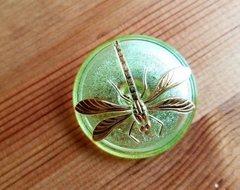 Vintage Czech glass green and gold dragonfly button. Lot of 1. (Jan29)