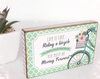 Life is like riding a bicycle, to keep your balance you must be moving forward...