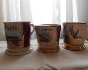 Three vintage decorative ceramic mugs