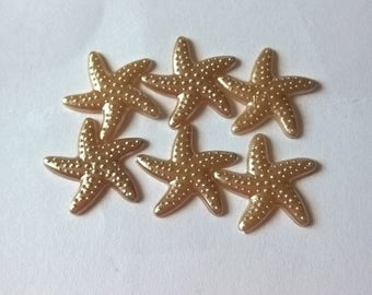 A Pack Of 20 Gold Coloured Starfish Shaped Cabochons