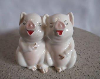 Beswick Laughing Pigs