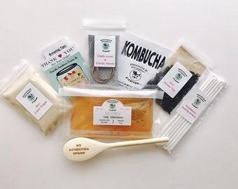 1 Gallon Kombucha Making Kit: SCOBY, tea, sugar, starter kombucha, ebook,etched wooden spoon, cloth cover and band.