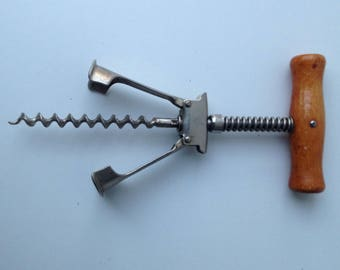 Vintage corkscrew with wooden handle