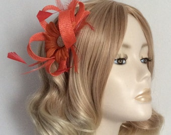BURNT ORANGE FASCINATOR, Made with sinamay, a Daisy flower,Feathers, on a comb