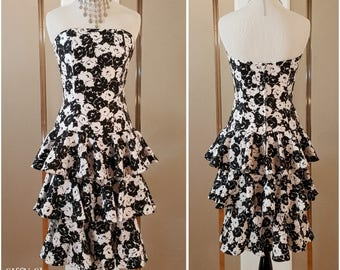 Black and white strapless tiered ruffle midi dress with floral poppy pattern