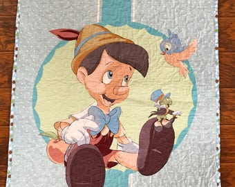 """Disney Classic Pinocchio 36""""W x 44""""L Stippling Quilted with 100% Cotton Backing* Crib blanket Disney Nursery Toddler Blanket"""