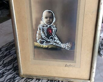 Vintage photo of child supported customized in baby skeleton (dias los muertos, curiosity, halloween)