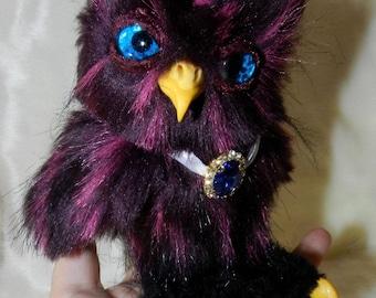 Magic owl with blue eyes