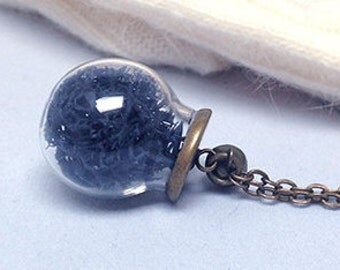 Long necklace with glass sphere and lichens