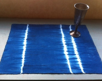 Four Shibori placemats indigo dyed lightweight cotton canvas with fringed edges