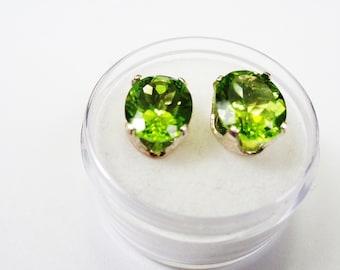 8 x 10mm. Oval Peridot, 2.25ct. each Stone, in Silver Stud Earrings.
