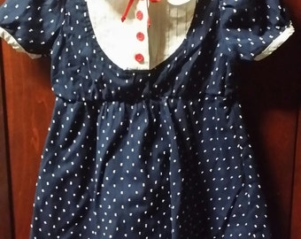 Little girl navy vintage dress, adorned with little white fuzzy dots.