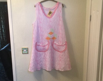 A Nice White Cotton Dress with a Pink Tie-Dye Effect Running throughout the fabric