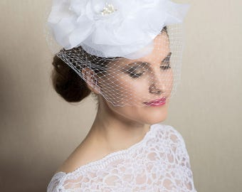 Couture bridal headpiece- birdcage veil produced from handmade silk flower and petit veil