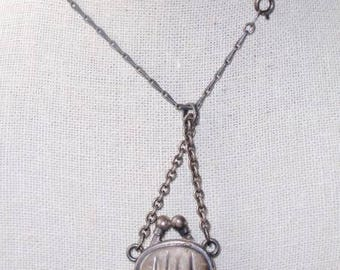 La Vie Parisienne - Catherine Popesco  pendant purse necklace