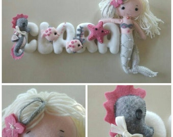 Name with felt letters decorated by hanging, stitchable