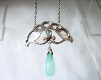 Beautiful Silver fan shaped pendant with aqua milk glass drop